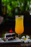 Cold wet orange juice and bakery. Cold wet orange juice on glass and bakery Royalty Free Stock Image