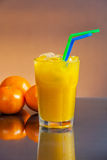Cold wet orange juice Stock Photography