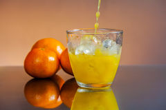 Cold wet orange juice Royalty Free Stock Image