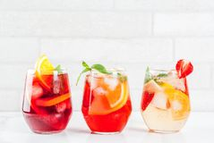 White, red and pink sangria. Cold white, pink and red sangria cocktails with fresh fruits, berries and mint stock photo
