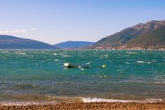 Cold wind on a sunny winter day. Montenegro. Cold wind on a sunny winter day. Bay of KotorAdriatic Sea,Tivat, Montenegro Stock Image