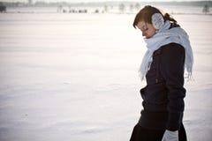 Cold winter. Girl in a cold winter scene Stock Image
