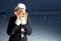 Cold winter. Woman outdoor in the snow Royalty Free Stock Photo