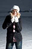Cold winter. Woman outdoor in the snow Royalty Free Stock Image