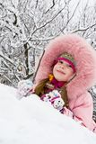 Cold Winter. Little girl in a winter clothing in a winter woods Royalty Free Stock Photos