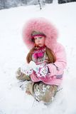 Cold Winter. Little girl in a winter clothing in a winter woods Royalty Free Stock Photography