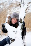 Cold Winter. Young woman in a winter clothing in a winter woods Royalty Free Stock Photos