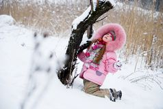 Cold Winter. Little girl in a winter clothing in a winter woods Stock Image