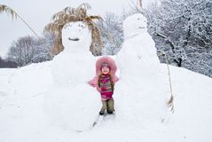 Cold Winter. Little girl in a winter clothing in a winter woods Royalty Free Stock Photo