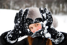 Cold Winter. Young woman in a winter clothing in a winter woods Royalty Free Stock Images