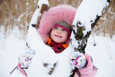 Cold Winter. Little girl in a winter clothing in a winter woods Stock Photo