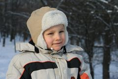 Cold winter. Little boy stock photo