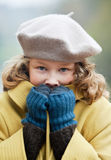 Cold winter day. Blond girl freezing up in a cold autumn day Royalty Free Stock Image