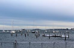 Cold winter day with sailboats in the harbor Royalty Free Stock Photo
