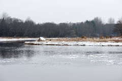 Cold winter landscape with frozen river Stock Image