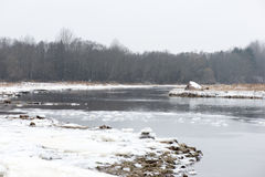Cold winter landscape with frozen river Royalty Free Stock Image