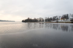 Cold winter landscape with frozen river Stock Photography