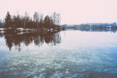 Cold winter landscape with frozen river. retro vintage polaroid Royalty Free Stock Image