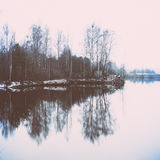 Cold winter landscape with frozen river. retro vintage polaroid Royalty Free Stock Photos