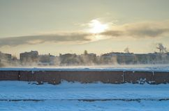 A cold winter morning. Street covered with snow. strong frost Royalty Free Stock Photo