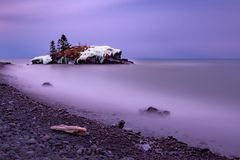 Hollow Rock Winter. A cold winter morning at Hollow Rock in Grand Portage, Minnesota along the shore of Lake Superior Stock Photography