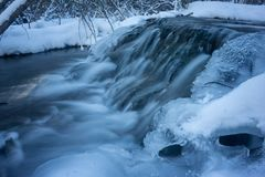 Cold Winter Morning Waterfall on Spring Fed Stream. Winter spring fed creek waterfalls in the icy cold winter foothills of Alberta, Canada stock photos