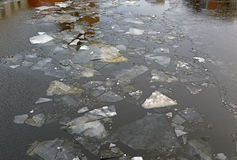 Cold winter scene with ice floating in river with icebergs and snow Stock Photo