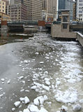 Cold winter scene with ice floating in river with icebergs and snow Royalty Free Stock Images