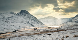 Cold winter scene Wales. A mountain in the Ogwen Valley, North Wales, called Tryfan. A very popular destination with climbers and ramblers who visit Snowdonia stock images