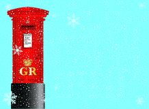 Christmas Post Box. A cold winter snowflake background with falling snow and a red British post box Royalty Free Stock Photos