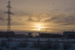 Cold winter sunset when the temperature outdoor is - 50 degree by Celsius. North. At the polar circle.  Stock Photo