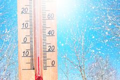 Cold winter weather - 10 degrees Celsius. Thermometer in winter frosty weather in the snow shows low temperatures - minus ten. Low. Temperatures in degrees royalty free stock photo
