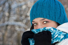 Cold winter woman. Covering her face in winter forest stock images