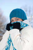 Cold winter woman. Covering her face in winter forest royalty free stock photo