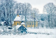 cold winter, wooden church in rural view Royalty Free Stock Image