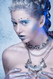 Cold winter Young woman with creative makeup Stock Image
