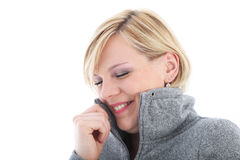 Cold woman cuddling into her jacket Stock Photo