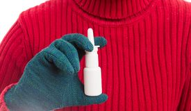 Cold woman hand with gloves holding nasal spray. As respiratory or rhinitis problem concept Stock Image