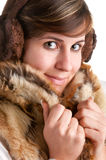 Cold Woman Snuggling in Warm Coat. Isolated in a white background Royalty Free Stock Image