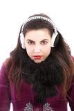 Cold woman wearing ear muffs Royalty Free Stock Image