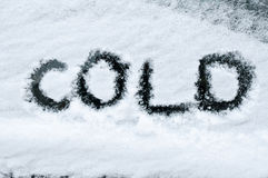 Cold written in snow Royalty Free Stock Photo