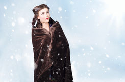 Cold young winter girl standing outdoor in snow Stock Photos