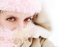 Cold young woman bundled up Royalty Free Stock Images