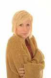 Cold young woman in cardigan. Half body portrait of cold young blond woman in cardigan with arms folded, isolated on white background royalty free stock photography