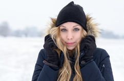 Cold young woman in a freezing winter landscape Royalty Free Stock Photography