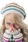 Cold Young Woman Wearing a Wooly Hat and Gloves Royalty Free Stock Photography