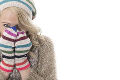 Cold Young Woman Wearing a Wooly Hat and Gloves. Attractive Cold Young Woman Wearing a Wooly Hat and Gloves Stock Image