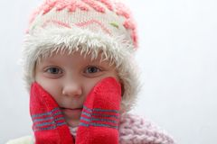 Coldly. An image of a child in red mittens stock photo