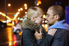 Coldly fall city. man and woman is embracing. Nightly street of coldly fall city. man and woman is embracing stock images