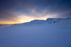 coldnesssolnedgångvinter royaltyfria bilder